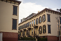 Row houses on Sylvan Terrace dating to 1882 are part of the Jumel Terrace Historic District, seen on Saturday, October 18, 2014. The wooden houses are adjacent to the Jumel-Morris Mansion.  (© Richard B. Levine)