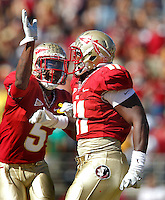 TALLAHASSEE, FL 10/29/11-FSU-NCST102911 CH-Florida State's Vince Williams, right, celebrates his interception with Greg Reid during second half action Saturday at Doak Campbell Stadium in Tallahassee. The Seminoles shut out the Wolfpack 34-0..COLIN HACKLEY PHOTO