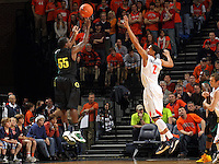 Dec. 17, 2010; Charlottesville, VA, USA; Oregon Ducks guard Jay-R Strowbridge (55) shoots over Virginia Cavaliers guard Mustapha Farrakhan (2) during the game at the John Paul Jones Arena. Virginia won 63-48. Mandatory Credit: Andrew Shurtleff