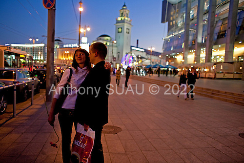Moscow, Russia<br /> September 21, 2009<br /> <br /> A couple kiss near the new Evropeisky shopping and entertainment center located across the street from Kievsky Train Station.