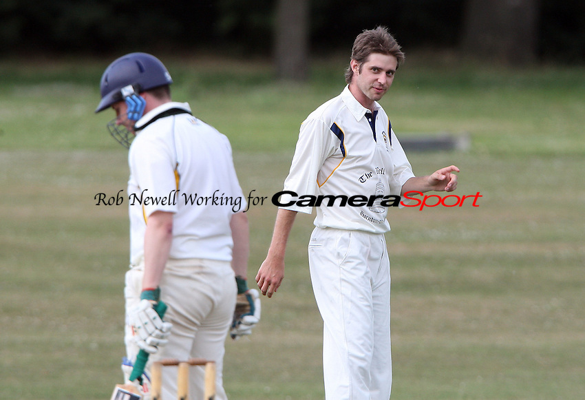 Jonathon Boyd of Horndon gives a stare to Harold Wood batsman David Hollingsworth - Harold Wood CC vs Horndon-on-the-Hill CC, Essex Club Cricket at Harold Wood Park, Harold Wood - 03/07/10 - MANDATORY CREDIT: Rob Newell/TGSPHOTO - Self billing applies where appropriate - 0845 094 6026 - contact@tgsphoto.co.uk - NO UNPAID USE.