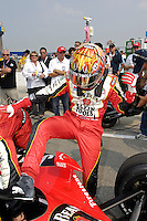 11 September, 2005, Joliet,IL,USA<br /> Dan Wheldon climbs into his car.<br /> Copyright&copy;F.Peirce Williams 2005