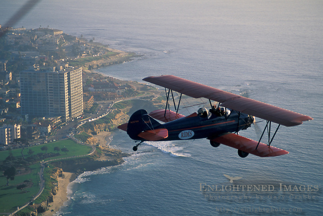 BiPlane over La Jolla area at+sunset, Northern San Diego Coastline San Diego County, CALIFORNIA