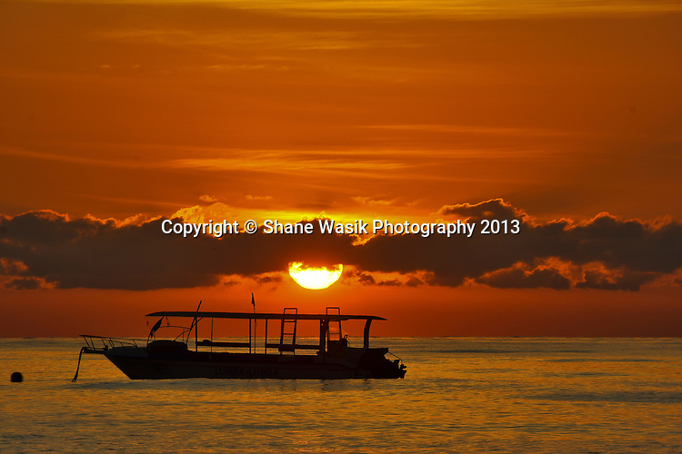 Sunrise over the dive boater