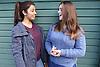 Teenage girls talking and laughing