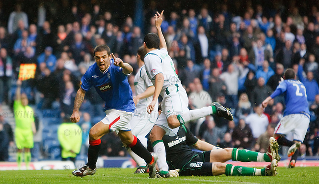 Nacho Novo latches on to Kris Boyd's shot in line with the last defender, turns and celebrates what he thinks is the winning goal but his goal is ruled offside in the last minute of added time