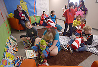 NWA Democrat-Gazette/BEN GOFF @NWABENGOFF<br /> Students and family read Dr. Seuss books Thursday, March 3, 2017, during the Read Across America Day event at Arkansas Connections Academy in Bentonville. Local students and their families made crafts before gathering to listen to recording artist Kris Allen read 'Go, Dog. Go!' by P.D. Eastman over the school's LiveLesson remote learning technology. The tuition-free virtual public charter school serving kindergarten through 9th grade students statewide is currently in it's first school year.