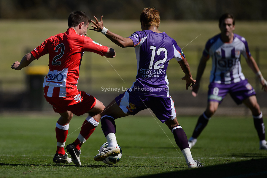 MELBOURNE - 22 September: Ryo NAGAI of the Glory competes for the ball with Michael MARRONE of the Heart  at a pre-season match between Melbourne Heart and Perth Glory at Epping Stadium on 22 September 2012. (Photo by Sydney Low / syd-low.com)