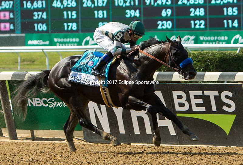 ELMONT, NY - JUNE 10: Mor Spirit #9, ridden by Mike Smith, wins the Mohegan Sun Metropolitan Handicap on Belmont Stakes Day at Belmont Park on June 10, 2017 in Elmont, New York (Photo by Sue Kawczynski/Eclipse Sportswire/Getty Images)