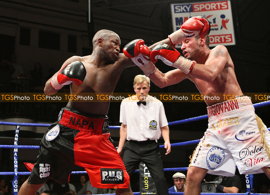 Ian Napa (Hackney, red/black shorts) defeats Carmelo Ballone (Belgium, white shorts) to win the European EBU Bantamweight Boxing Title at York Hall, Bethnal Green, promoted by FTM Sports/Maloney Promotions -  17/10/08 - MANDATORY CREDIT: Gavin Ellis/TGSPHOTO - Self billing applies where appropriate - Tel: 0845 094 6026