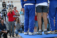 02 NOV 2003 -  ATHENS, GREECE - Finishers pose for photographs at the end of the 21st Athens Classic Marathon. (PHOTO (C) NIGEL FARROW)
