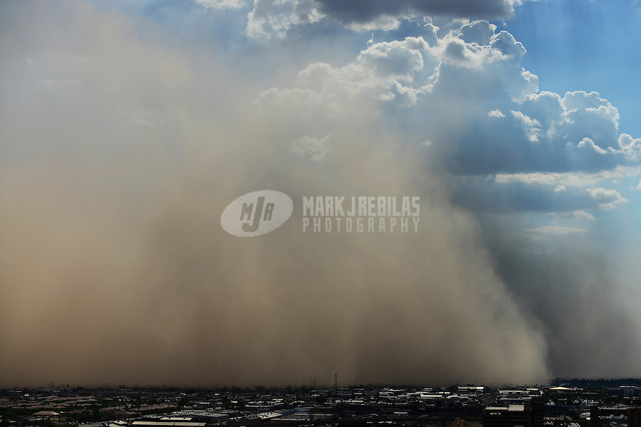 Phoenix downtown thunderstorm weather storm chaser chasing clouds sky Arizona rain dust haboob sand sun monsoon industrial