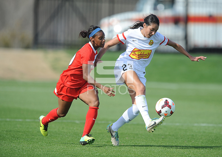 Boyds MD - April 13, 2014: Haley Palmer (23) of the Western New York Flash shields the ball against Crystal Dunn (19) of the Washington Spirit. The Western New York Flash defeated the Washington Spirit 3-1 in the opening game of the 2014 season of the National Women's Soccer League at the Maryland SoccerPlex.