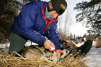 "Wednesday March 7, 2007   ----  Hans Gatt applies foot ointment to ""chester"" at the Ophir checkpoint."