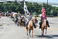 Horseback riders lead the Harrison Roundup Club's wagon train Friday, June 19, 2020, into downtown Harrison. Nine wagons and 49 horses left the Northwest Arkansas District Fairgrounds in Harrison and traveled through downtown before heading out on a five-day and five night trip to Blue Springs located just east of Springdale. The annual wagon train, a tradition since 1977 normally would arrive to participate in the Rodeo of the Ozarks parade in Springdale but because of the covid-19 pandemic, the rodeo has been postponed. Visit nwaonline.com/200620Daily/ and nwadg.com/photos for a photo gallery.<br /> (NWA Democrat-Gazette/David Gottschalk)