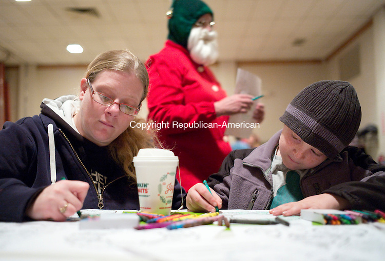 Torrington, CT- 04 December 2015-1204115CM16-  Jennifer Murray and her son, Justin Murray, 7, of Torrington color in pictures during a Christmas Village Toy Shower at Coe Park in Torrington on Friday.   The event which featured, musical performances, crafts and refreshments was held to raise money to support the town's Christmas Village and to<br /> purchase toys for all children who visit Santa at the Village.       Christopher Massa Republican-American