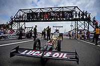 Apr. 29, 2012; Baytown, TX, USA: Fans look on as NHRA top fuel dragster driver Morgan Lucas waits in his car prior to the semi finals of the Spring Nationals at Royal Purple Raceway. Mandatory Credit: Mark J. Rebilas-
