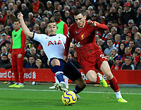 27th October 2019; Anfield, Liverpool, Merseyside, England; English Premier League Football, Liverpool versus Tottenham Hotspur; Andy Robertson of Liverpool is tackled by Harry Winks of Tottenham Hotspur - Strictly Editorial Use Only. No use with unauthorized audio, video, data, fixture lists, club/league logos or 'live' services. Online in-match use limited to 120 images, no video emulation. No use in betting, games or single club/league/player publications