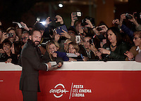 British actor Ralph Fiennes signs autographs on the red carpet as he arrives for a special screening of the movie &quot;The English Patient&quot; during the international Rome Film Festival at Rome's Auditorium, 22 October 2016. The Film Festival celebrates one of the most beloved of Cinema History 'The English Patient' by Anthony Minghella, released twenty years ago (in 1996). <br /> UPDATE IMAGES PRESS/Isabella Bonotto