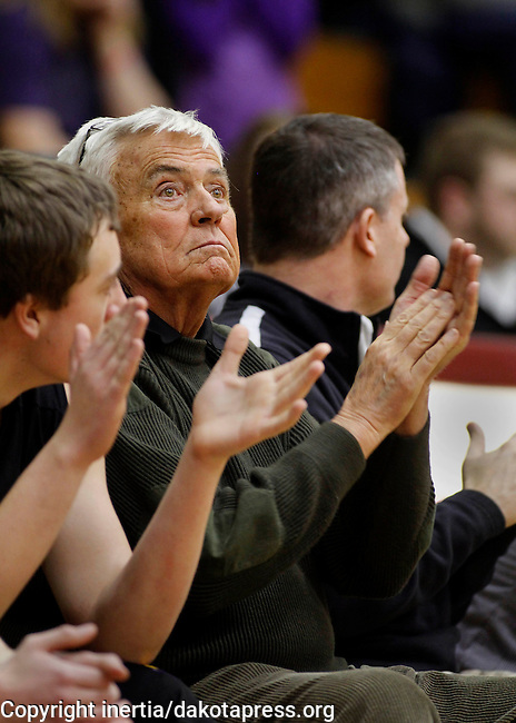 LEAD, SD - FEBRUARY 21, 2014:  Custer High School Boys basketball coach Larry Luitjens applauds his players during a game with Lead-Deadwood Friday February 21, 2014 in Lead, S.D.  Luitjens is retiring after more than 40 years coaching.  (Photo by Dick Carlson/Inertia)