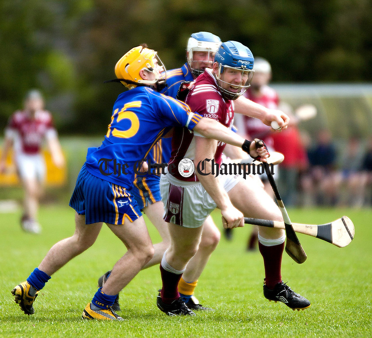 290511.St Josephs Ken Kennedy under pressure from Killanenas David McNamara and Padraig Brady during their Senior Hurling Championship Round 2 match at Sixmilebridge on Sunday.