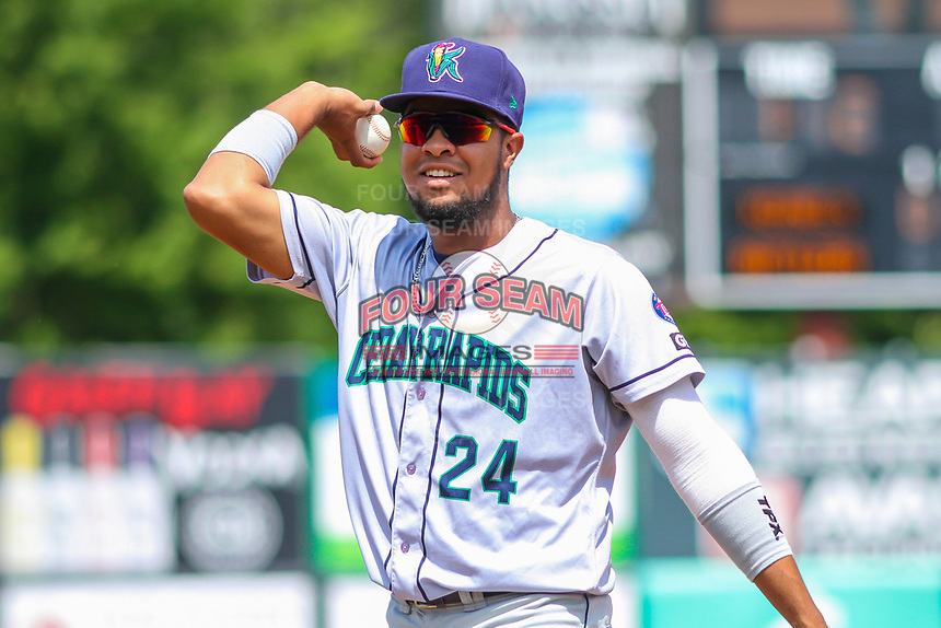Cedar Rapids Kernels first baseman Amaurys Minier (24) throws a ball into the dugout between innings during a Midwest League game against the Wisconsin Timber Rattlers on August 6, 2017 at Fox Cities Stadium in Appleton, Wisconsin.  Cedar Rapids defeated Wisconsin 4-0. (Brad Krause/Four Seam Images)