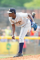 Charleston RiverDogs starting pitcher Luis Severino (6) follows through on his delivery against the Hickory Crawdads at L.P. Frans Stadium on May 25, 2014 in Hickory, North Carolina.  The RiverDogs defeated the Crawdads 17-10.  (Brian Westerholt/Four Seam Images)