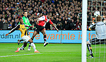 Nederland, Rotterdam, 31 maart 2012.Eredivisie.Seizoen 2011-2012.Feyenoord-NAC Breda.Sekou Cisse van Feyenoord scoort de 3-1. Links Roly Bonevacia van NAC Breda. Rechts Jelle ten Rouwelaar, keeper (doelman) van NAC Breda
