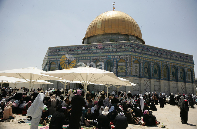 Palestinians Muslims pray in front of the Dome of the Rock on the compound known to Muslims as al-Haram al-Sharif during the first Friday of the holy month of Ramadan in Jerusalem's Old City August 5, 2011. Muslims around the world abstain from eating, drinking and sexual relations from sunrise to sunset during Ramadan, the holiest month in the Islamic calendar. Photo by Mahfouz Abu Turk