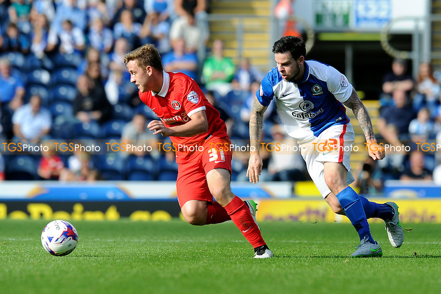 Mikhail Kennedy of Charlton Athletic gets away from Danny Guthrie of Blackburn Rovers during Blackburn Rovers vs Charlton Athletic, Sky Bet Championship Football at Ewood Park, Blackburn, England on 19/09/2015