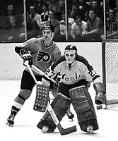 California Golden Seals goalie Gilles Meloche with Philadelphia Flyer Ross Lonsberry.1972 photo/Ron Riesterer)