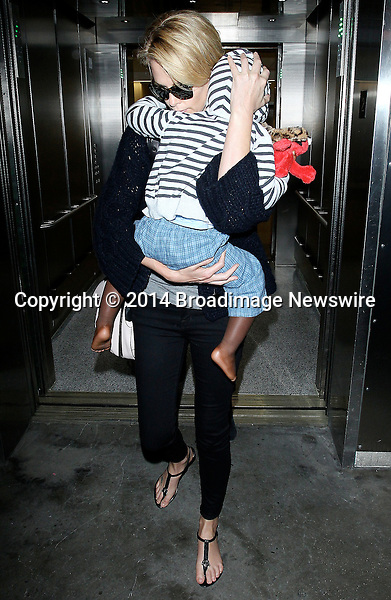 Pictured: Charlize Theron, Jackson<br /> Mandatory Credit &copy; CALA/Broadimage<br /> Charlize Theron and baby Jackson arriving at the Los Angeles International Airport<br /> <br /> 3/20/14, Los Angeles, California, United States of America<br /> <br /> Broadimage Newswire<br /> Los Angeles 1+  (310) 301-1027<br /> New York      1+  (646) 827-9134<br /> sales@broadimage.com<br /> http://www.broadimage.com