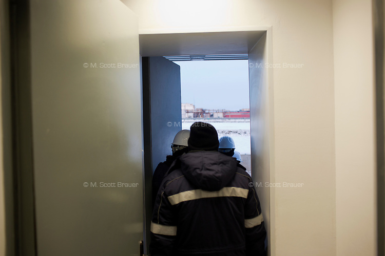 Workers exit the office area to tour the refinery at a Bashneft oil refinery outside of Ufa, Bashkortostan, Russia. The area is a major oil and gas producing region in the country.