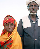ERITREA, Saroita, portrait of an Afar Mr. Bedri and his daughter in front of their home in the small village of Saroita
