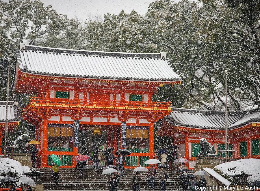 Kyoto City, Japan<br /> Yasaka Shrine, Gion district, vermilion gate in snow