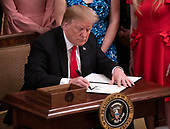 """United States President Donald J. Trump makes remarks and signs an executive order that will require colleges that receive federal research grant money to certify that they """"promote free inquiry"""" in the East Room of the White House in Washington, DC on Thursday, March 21, 2019.<br /> Credit: Ron Sachs / CNP"""