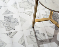 Kubuni Grand, a hand-cut and waterjet mosaic, shown in polished Thassos and Calacatta Tia. Designed by Joni Vanderslice as part of the J. Banks Collection for New Ravenna.