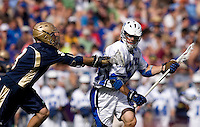 Mike Catalino (29) of Duke is defended by Adam Felicetti (3) of Notre Dame during the NCAA Men's Lacrosse Championship held at M&T Stadium in Baltimore, MD.  Duke defeated Notre Dame, 6-5, to win the title in overtime.