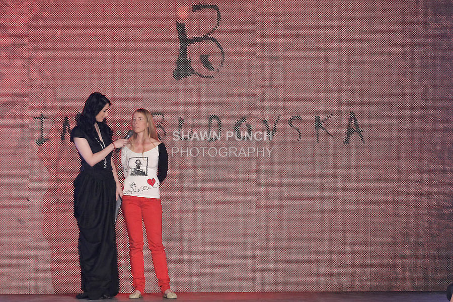 "Moderator and fashion model lucia hablovicova, interviews Ina Budovska ashion designer at the close of the Ina Budovska 2012 ""Pink Punk Slovak Experiences"" collection fashion show, during the Factory Fashion Show 2012, organized by Ina Budovksa in Trencin Slovakia, May 3, 2012."