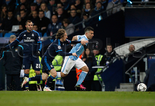 26.04.2016. The Etihad, Manchester, England. UEFA Champions League. Manchester City versus Real Madrid. Manchester City striker Sergio Agüero takes the ball past Real Madrid midfielder Luka Modric.