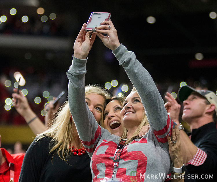 Three Georgia Bulldogs fans take a selfie in the fourth quarter of the NCAA College Football Playoff National Championship against the Alabama Crimson Tide at Mercedes-Benz Stadium on January 8, 2018 in Atlanta. Alabama defeated Georgia 26-23 in overtime.  Photo by Mark Wallheiser/UPI