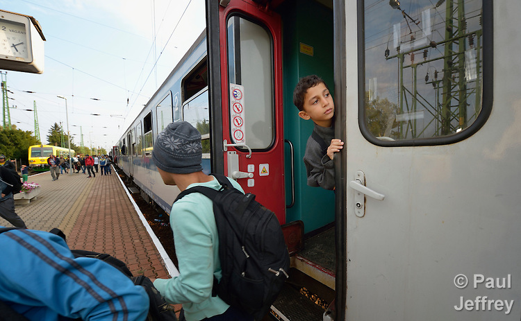 A refugee boy seems unsure about getting off a train as it arrives in the Hungarian town of Hegyeshalom. Migrants and refugees aboard the train walk from here across the border into Austria. Hundreds of thousands of refugees and migrants flowed through Hungary in 2015, on their way to western Europe from Syria, Iraq and other countries.
