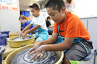 NWA Democrat-Gazette/DAVID GOTTSCHALK Joaquin Jorge, a fifth grade student at John Tyson Elementary School, works a small bowl Monday, September 9, 2019, inside the Community Creative Center's Wheel Mobile Traveling Art Studio parked at the school in Springdale. Students from Valarie Traylor's art classes have the opportunity make small bowls or cups inside the recreational and educational vehicle.