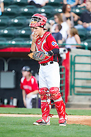 Hickory Crawdads catcher Kellin Deglan (6) gives defensive signals to his infielders during the South Atlantic League game against the Asheville Tourists at L.P. Frans Stadium on April 13, 2014 in Hickory, North Carolina.  The Tourists defeated the Crawdads 5-4.  (Brian Westerholt/Four Seam Images)