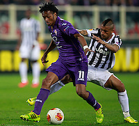Calcio, ritorno degli ottavi di finale di Europa League: Fiorentina vs Juventus. Firenze, stadio Artemio Franchi, 20 marzo 2014. <br /> Fiorentina midfielder Juan Cuadrado, of Colombia, is challenged by Juventus midfielder Arturo Vidal, of Chile, of Argentina, right, during the Europa League round of 16 second leg football match between Fiorentina and Juventus at Florence's Artemio Franchi stadium, 20 March 2014. Juventus won 1-0 to advance to the round of eight.<br /> UPDATE IMAGES PRESS/Isabella Bonotto