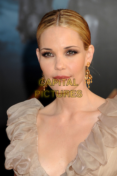 "LESLIE BIBB .""Iron Man 2"" World Premiere held at the El Capitan Theatre, Hollywood, California , USA, .26th April 2010..arrivals portrait headshot hair up gold earrings dangly  beige sleeveless  .CAP/ADM/BP.©Byron Purvis/AdMedia/Capital Pictures."