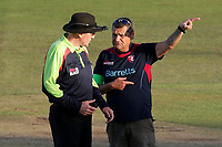 Umpire Rob Bailey speaks to the ground staff as the low sun causes play to be suspended during Kent Spitfires vs Essex Eagles, Vitality Blast T20 Cricket at the St Lawrence Ground on 2nd August 2018