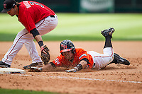 Sam Houston State Bearkats second baseman Shea Pierce #2 slides head first into third base as Texas Tech Red Raiders third baseman Jake Barrios #3 tags him out during the NCAA baseball game on March 1, 2014 during the Houston College Classic at Minute Maid Park in Houston, Texas. The Bearkats defeated the Red Raiders 10-6. (Andrew Woolley/Four Seam Images)