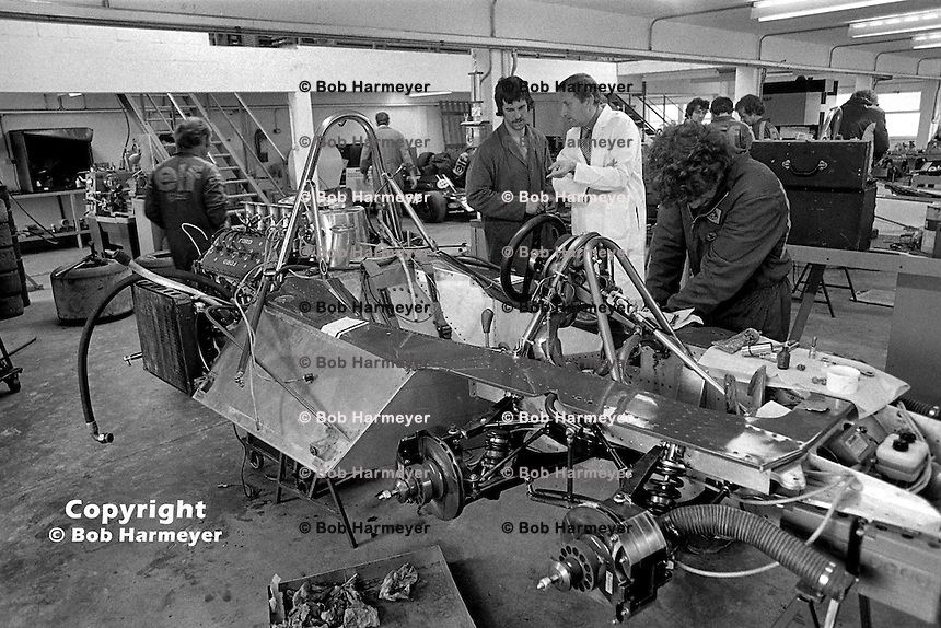 Derek Gardner(center, white coat), designer of the Tyrrell P34 six-wheel Formula 1 car, speaks with a crew member in the Tyrrell race shop near Ockham, Surrey. Gardner originally designed the car as a four-wheel drive entry for the Indianapolis 500, before USAC changed the regulations and abolished four-wheel drive machines.