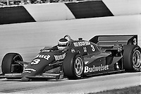 WEST ALLIS, WI - JUNE 2: Bobby Rahal drives his Budweiser March 85C/Cosworth during practice for the Miller American 200 CART IndyCar race at the Milwaukee Mile in West Allis, Wisconsin, on June 2, 1985.